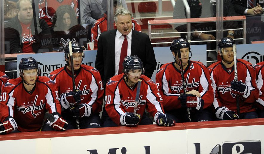 Washington Capitals head coach Dale Hunter, top center, seen in the bench area during the first period of an NHL game against the St. Louis Blues, Tuesday, Nov. 29, 2011, in Washington. (AP Photo/Nick Wass)