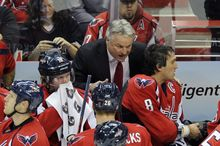 Washington Capitals head coach Dale Hunter, center, talks with Alex Ovechkin (8) and Nicklas Backstrom during the first period of an NHL game against the St. Louis Blues, Tuesday, Nov. 29, 2011, in Washington. (AP Photo/Nick Wass)