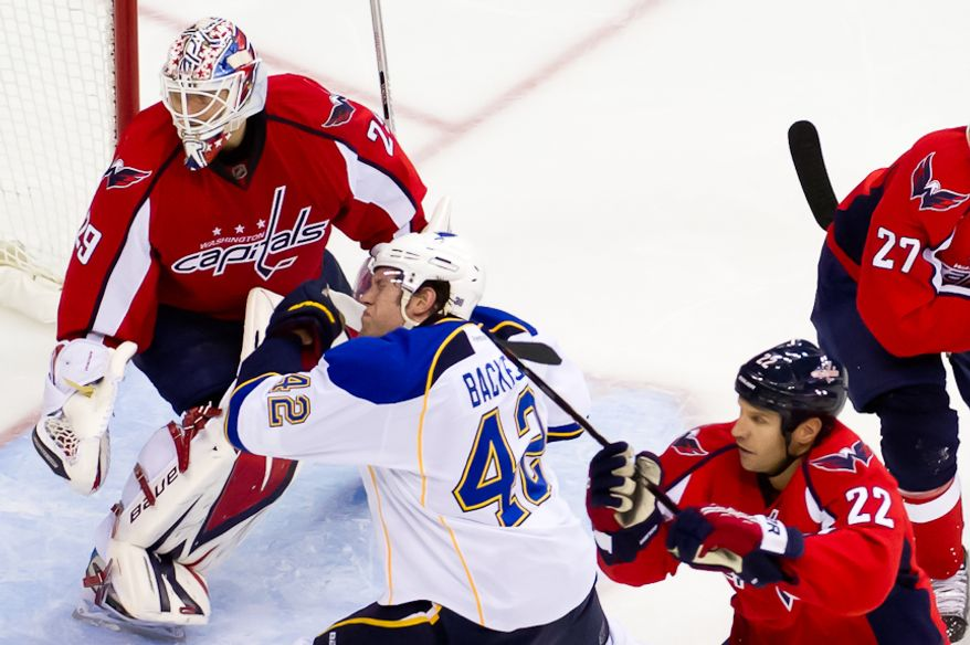 St. Louis Blues center David Backes (42) gets a stick to the face by Washington Capitals right wing Mike Knuble (22) during the second period as the Washington Capitals take on the St. Louis Blues, Washington, DC November 29, 2011. (Andrew Harnik/The Washington Times)