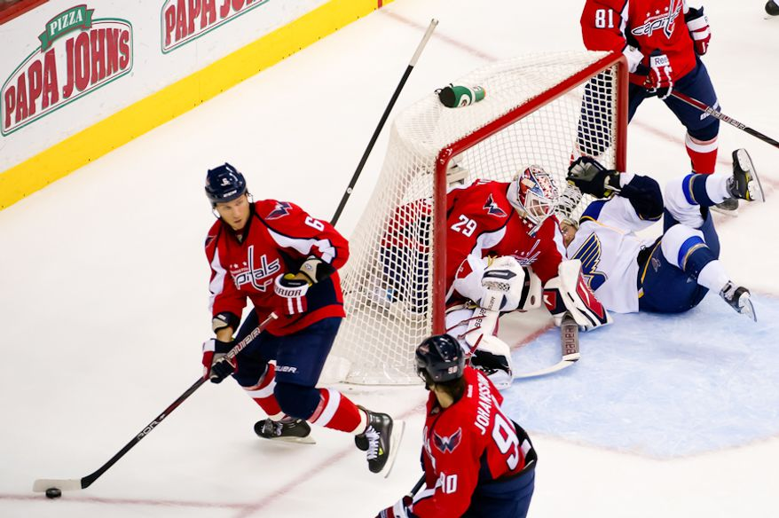 St. Louis Blues defenseman Kris Russell (4) collides with Washington Capitals goalie Tomas Vokoun (29) after taking a shot on goal during the second period as the Washington Capitals take on the St. Louis Blues, Washington, DC, November 29, 2011. (Andrew Harnik/The Washington Times)