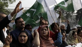 Protesters condemn the weekend NATO strikes on Pakistani border posts as they demonstrate in Lahore, Pakistan, on Monday, Nov. 28, 2011. (AP Photo/K.M.Chaudary)