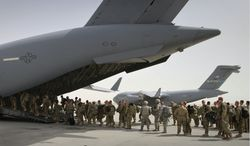 ** FILE ** U.S. soldiers board a military plane as they leave Afghanistan from the U.S. base in Bagram Air Field north of Kabul, Afghanistan, on Thursday, July 14, 2011. (AP Photo/Musadeq Sadeq)