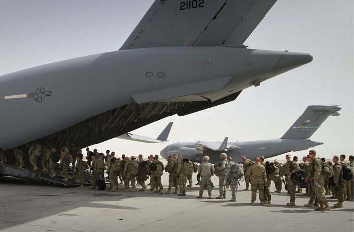 ** FILE ** U.S. soldiers board a military plane as they leave Afghanistan from the U.S. base in Bagram Air Field north of Kabul, Afghanistan, on Thursday, July 14, 2011. (AP