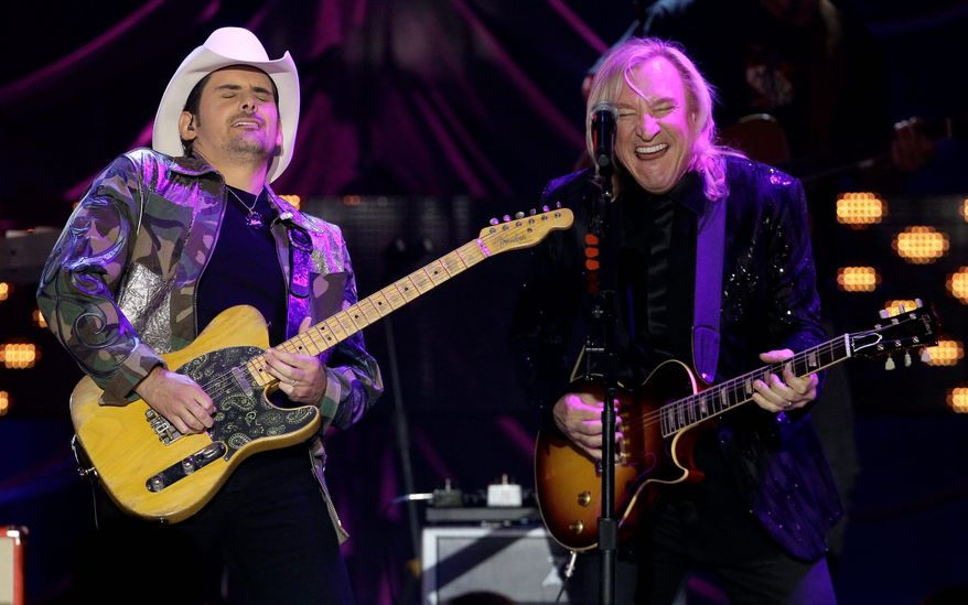 Joe Walsh (right) was among the guests on hand to honor Brad Paisley and four other stars honored Tuesday night as Country Music Television's Artists of the Year. Jason Aldean, Kenny Chesney, Lady Antebellum and Taylor Swift shared the honor with Mr. Paisley. (Associated Press)