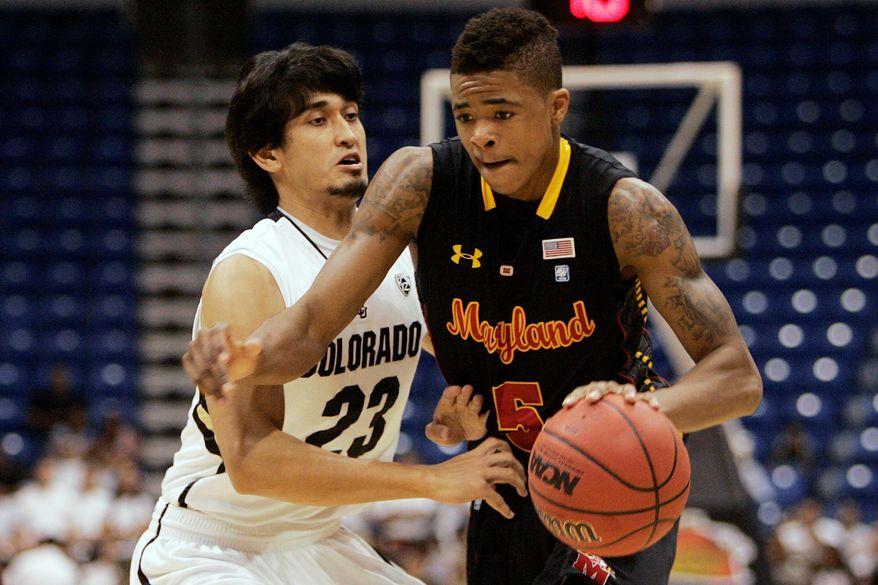 Maryland freshman Nick Faust (right), shown during the San Juan tournament, has 17 turnovers and 15 assists from the point guard position. He's one of two Terrapins to start every game. (Associated Press)