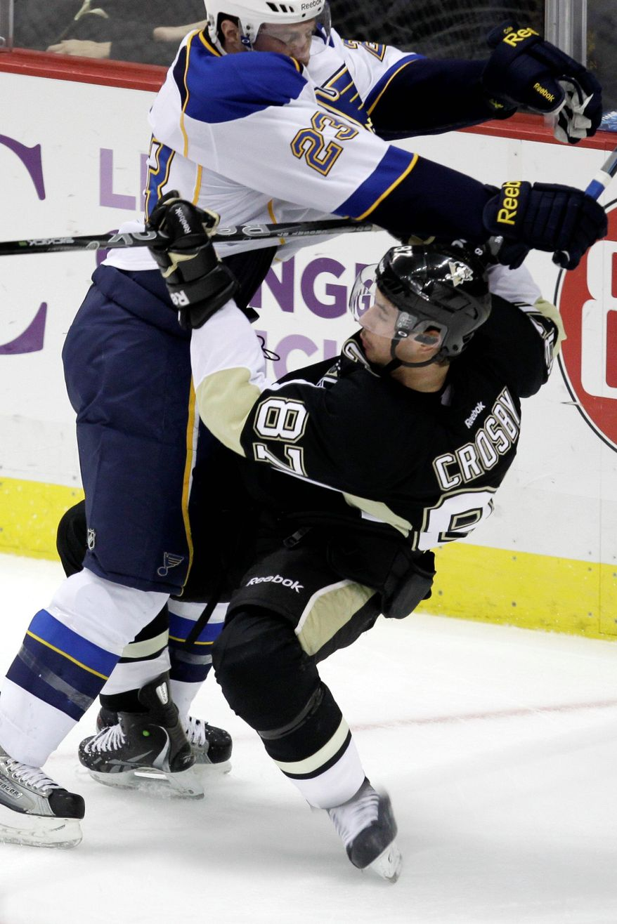 Penguins center Sidney Crosby, taking a hit from St. Louis defenseman Ian Cole on Nov. 23, has two goals and nine assists in five games since returning from a 10 1/2-month layoff absence because of post-concussion symptoms. (Associated Press)