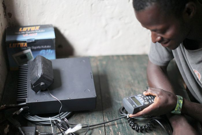 A local operator reports security information into the Early Warning Radio Network, which supplies radios to remote jungle villages in Congo, Central African Republic and South Sudan so villagers can report attacks by the brutal Lord's Resistance Army. (Invisible Children via Associated Press)
