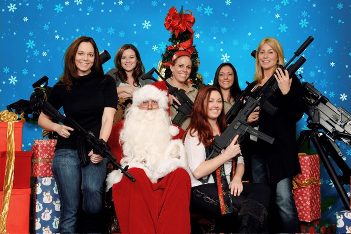 Six well-armed women are among the many people who have taken up the Scottsdale Gun Club's offer for a ready-for-the-Christmas-card photograph with Santa Claus, complete with semiautomatic assault weapons.