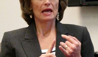 """""""There are a number of statements that are either inaccurate or simply not well-considered"""" in the report on the postal """"Alaska Bypass"""" program, said Sen. Lisa Murkowski, Alaska Republican. (Associated Press)"""