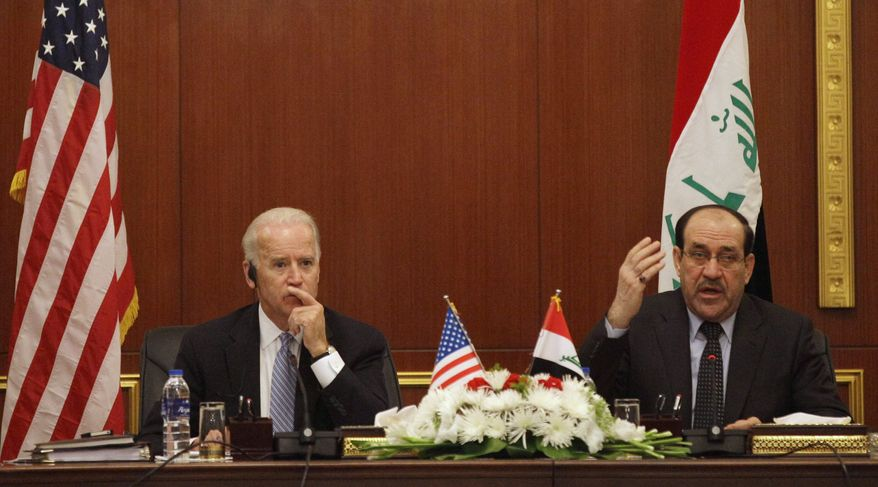 U.S. Vice President Joseph R. Biden Jr. (left) and Iraqi Prime Minister Nouri al-Maliki hold a joint news conference in Baghdad on Wednesday, Nov. 30, 2011. (AP Photo/Khalid Mohammed)