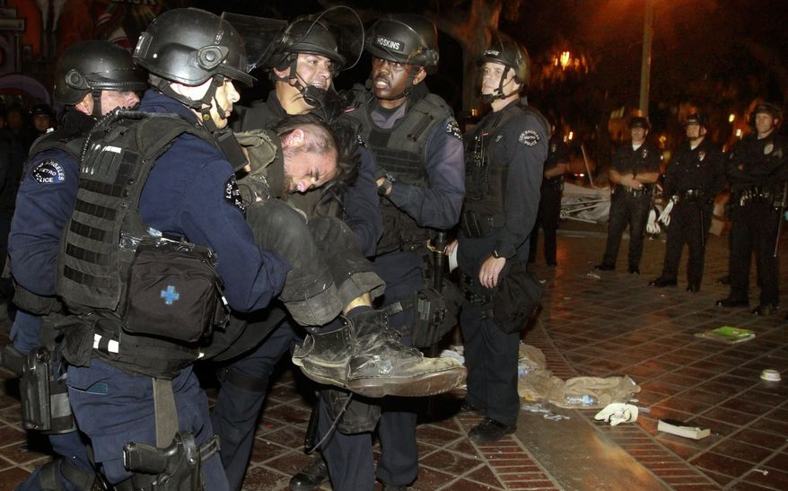 Police arrest an Occupy L.A. protester as they cleared out the Occupy L.A. camp at Los Angeles City Hall on Wednesday, Nov. 30, 2011. (AP Photo/Mark Boster, Pool)