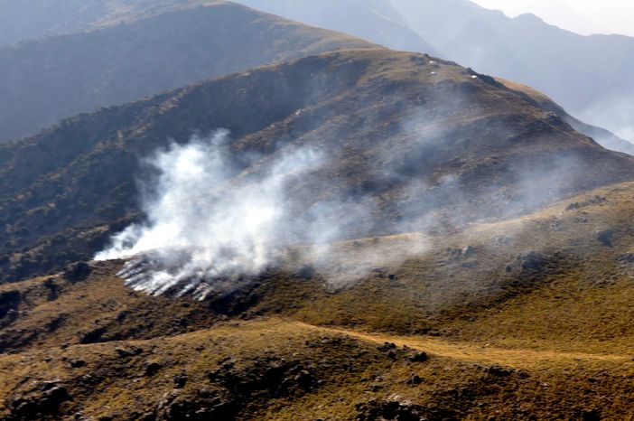 ** FILE ** Smoke rises after a reported NATO airstrike in Pakistan's tribal area of Mohmand, along the Afghanistan border, on Saturday, Nov. 26, 2011. (AP Photo/Pakistan Inter Services Public Relations Department)