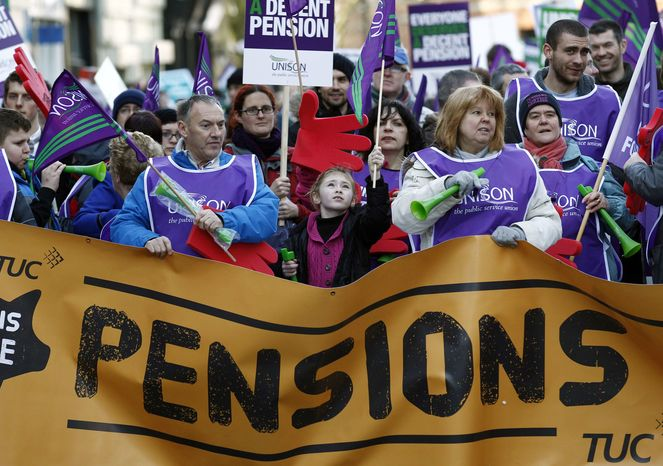 Marchers gather in central Manchester, England, during public sector strikes, Wednesday, Nov. 30, 2011. (AP Photo/Jon Super).