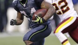 ** FILE ** Seattle Seahawks Marshawn Lynch, right, runs under pressure from Washington Redskins Kevin Barnes in the second half of an NFL football game, Sunday, Nov. 27, 2011, in Seattle. (AP Photo/Ted S. Warren)