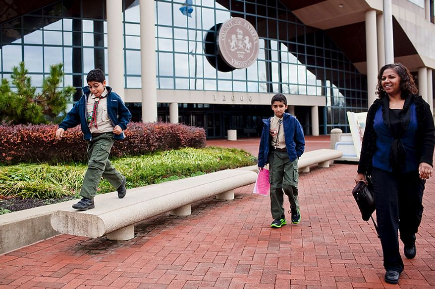 Brinda Grapin, right, and her sons Sean, 9, from left, and Eric, 11, leave the Fairfax County Board of Zoning and Appeals after being granted an ordinance that allows the family to keep a treehouse in their front yard, in Fairfax, Va., on Nov. 30, 2011. (T.J. Kirkpatrick/The Washington Times)