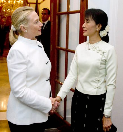 ** FILE ** Secretary of State Hillary Rodham Clinton greets democracy advocate leader Aung San Suu Kyi at the U.S. chief of mission residence in Yangon, Myanmar, in December 2011. (Associated Press)