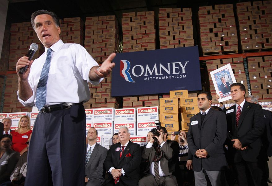 Republican presidential candidate Mitt Romney stumps in Florida. He has dramatically boosted his campaigning in Iowa with just a month to go before caucuses there. (Associated Press)