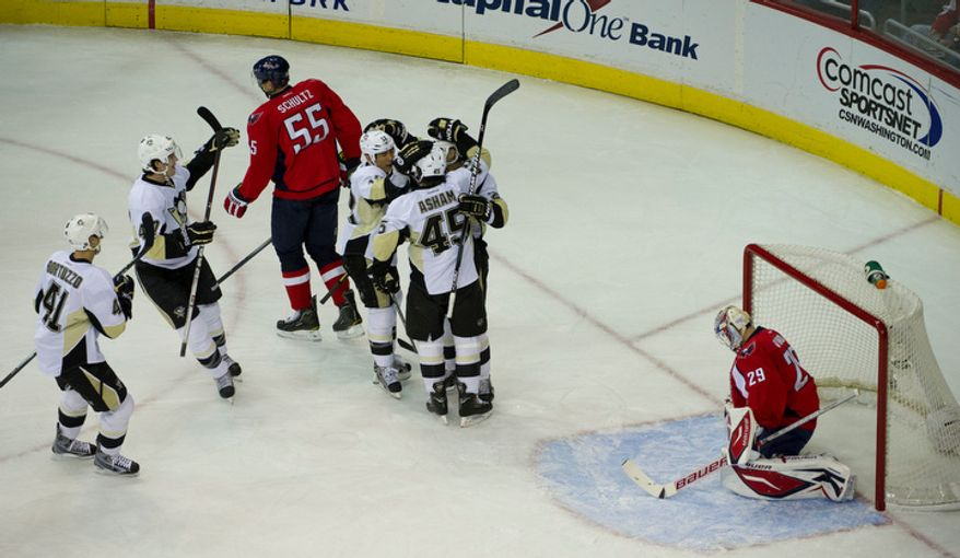 The Pittsburgh Penguins celebrate Craig Adams' goal in the first period against the Washington Capitals at Verizon Center in Washington, Thursday, Dec. 1, 2011. (Rod Lamkey Jr/ The Washington Times)