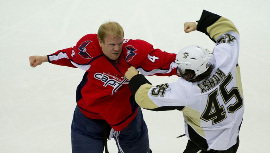 Washington Capitals John Erskine (4) gets into a fight with Pittsburgh Penguins Arron Asham (45) in the first period as the Washington Capitals host the Pittsburg Penguins at the Verizon Center in Washington, DC, Thursday, December 1, 2011. (Rod Lamkey Jr/ The Washington Times)