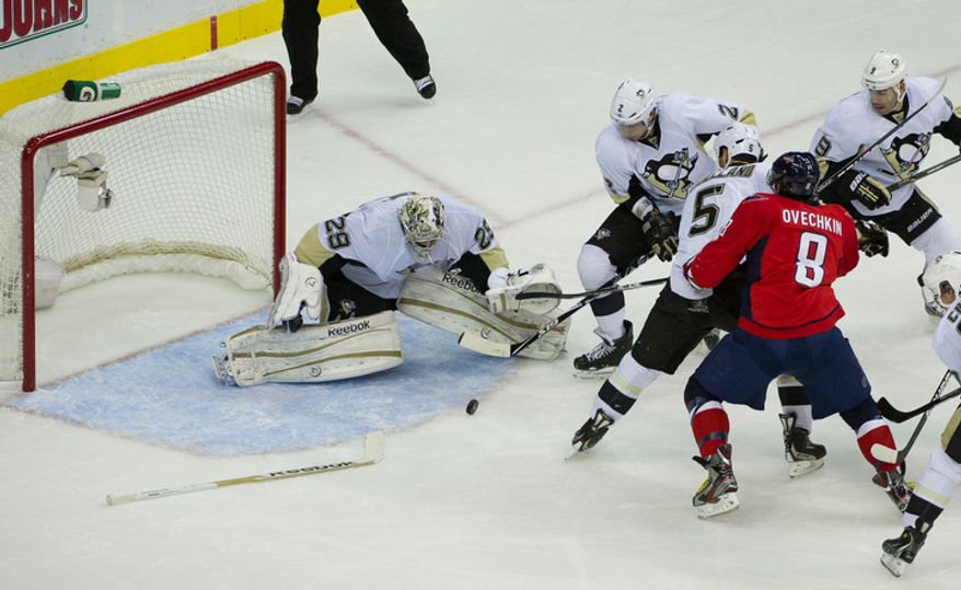 Washington Capitals Alex Ovechkin (8) tries to score as he defended against by a group of Pittsburgh Penguins in the first period as the Washington Capitals host the Pittsburg Penguins at the Verizon Center in Washington, DC, Thursday, December 1, 2011. (Rod Lamkey Jr/ The Washington Times)
