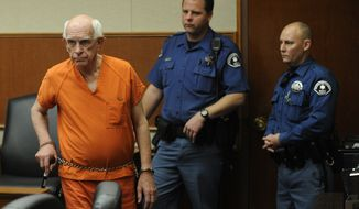 Former Arapahoe County, Colo., Sheriff Patrick Sullivan (left) appears in court on Wednesday, Nov. 30, 2011, on charges of offering methamphetamine in exchange for sex from a male acquaintance. (AP Photo/R.J. Sangosti, Pool)