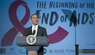 President Obama announces a renewed American commitment to making HIV treatment available in the United States and around the world during a speech Dec. 1, 2011, on World AIDS Day at George Washington University in Washington. (Associated Press)