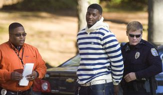 Oakland Raiders football player Rolando McClain is arrested and handcuffed by Decatur (Ala.) Police captain Nadis Carlisle, left, and officer Kirk Hamilton, Thursday afternoon, Dec. 1, 2011. McClain was arrested and charged with assault in the third degree, menacing, reckless endangerment and discharging a firearm inside the city limits in an incident that took place late Wednesday night, Nov. 30, 2011, in his hometown of Decatur. (AP Photo/The Decatur Daily, John Godbey)