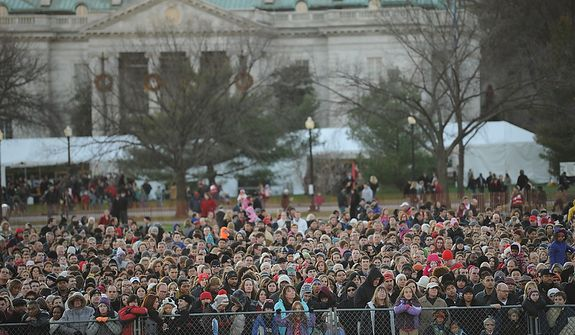 People crowd up along a fence for a glimpse of the celebrations, during The National Christmas Tree Lighting 2011 on The Elipse in Washington, DC, Thursday, December 1, 2011. (Rod Lamkey Jr/ The Washington Times)