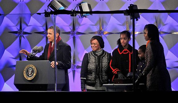 President Barack Obama, first lady Michelle Obama, daughters Malia and Sasha Obama, and mother-in-law Marian Robinson, center, participate in the lighting of the National Christmas Tree at the Ellipse across from the White House in Washington, Thursday, Dec., 1, 2011. (AP Photo/Pablo Martinez Monsivais)