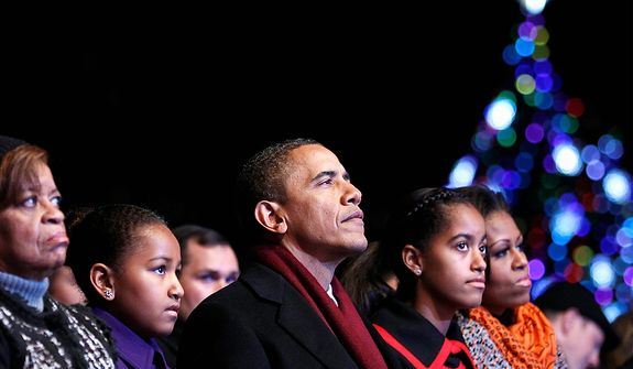 President Barack Obama, first lady Michelle Obama and their daughters Sasha and Malia along with mother-in-law Marian Robinson attend the annual National Christmas Tree Lighting on the Ellipse, Thursday, Dec. 1, 2011, Washington. (AP Photo/Haraz N. Ghanbari)