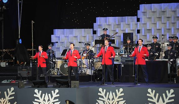Cast members from the National Tour of the Jersey Boys sing for the crowd during The National Christmas Tree Lighting 2011 on The Elipse in Washington, DC, Thursday, December 1, 2011. (Rod Lamkey Jr/ The Washington Times)