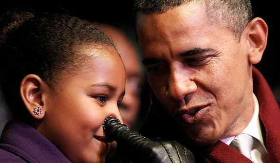 President Barack Obama jokes with his daughter Sasha as they sing Rudolph the Red Nose Reindeer while attending the annual National Christmas Tree Lighting on the Ellipse, Thursday, Dec. 1, 2011, Washington. (AP Photo/Haraz N. Ghanbari)