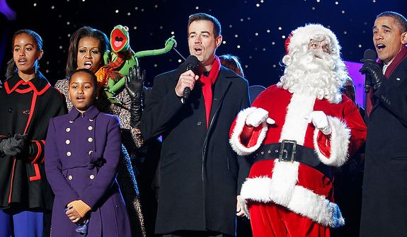 President Barack Obama, first lady Michelle Obama and their daughters Sasha and Malia, left, sing along with performers during the annual National Christmas Tree Lighting on the Ellipse, Thursday, Dec. 1, 2011, Washington. (AP Photo/Haraz N. Ghanbari)
