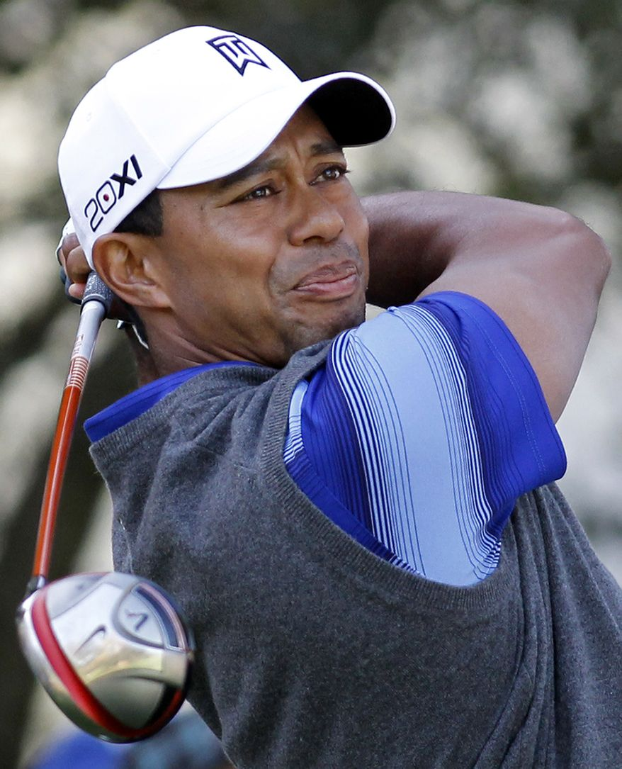 Tiger Woods tees off on the second hole during the second round of the Chevron World Challenge golf tournament at Sherwood Country Club, Friday, Dec. 2, 2011, in Thousand Oaks, Calif. (AP Photo/Danny Moloshok)