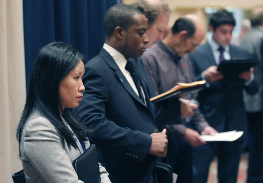 ** FILE ** In this Nov. 14, 2011, file photo, job seekers line up to speak to recruiters during a career expo in Las Colinas, Texas. (AP Photo/LM Otero, File)