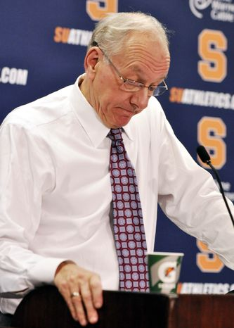 Syracuse head coach Jim Boeheim reacts Dec. 2, 2011, after apologizing for statements he made earlier about the Bernie Fine sexual abuse case in a postgame press conference after Syracuse defeated Florida 72-68 in Syracuse, N.Y. (Associated Press)
