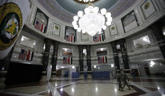 ** FILE ** In this April 26, 2011, photo, U.S. Army soldiers walk through Al Faw palace in Camp Victory Baghdad, Iraq. Victory Base Complex, as it's formally called by the military, started life as a country club for the Baghdad elite under Saddam. (AP Photo/Khalid Mohammed)