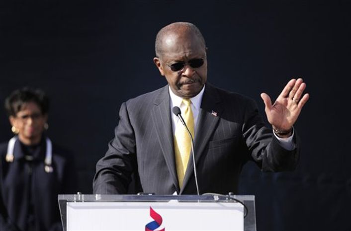 Republican presidential candidate Herman Cain announces he is suspending his campaign as his wife, Gloria (left), looks on, on Saturday, Dec. 3, 2011, in Atlanta. (AP Photo/David Tulis)