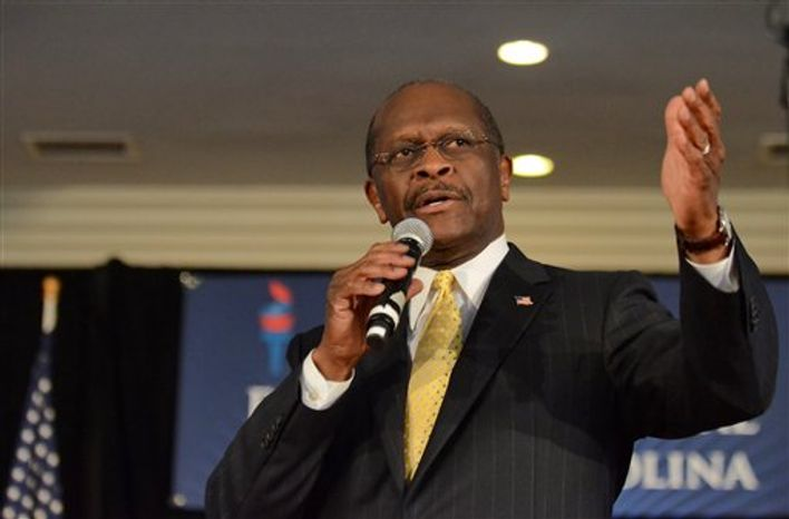 **FILE** Herman Cain speaks Dec. 2, 2011, to campaign supporters in Rock Hill, S.C. (Associated Press)