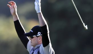 Zach Johnson reacts after hitting an eagle shot from the 18th fairway during the third round of the Chevron World Challenge at Sherwood Country Club, Saturday, Dec. 3, 2011, in Thousand Oaks, Calif. (AP Photo/Los Angeles Daily News, John McCoy)