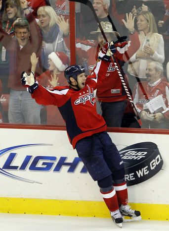 Washington Capitals center Brooks Laich celebrates his game-winning goal 12 seconds into overtime against the Ottawa Senators in Washington, Saturday, Dec. 3, 2011. The Capitals won 3-2. (AP Photo/Ann Heisenfelt)