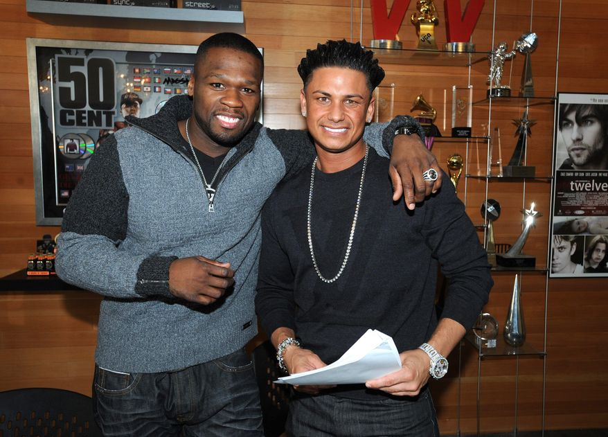 """DJ Pauly D (right) has signed a record deal with 50 Cent's G-Note label, which focuses on dance and pop music. The """"Jersey Shore"""" star has been in music since he was 15 and opened for Britney Spears' recent tour a few times. (Associated Press)"""