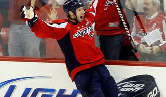 Capitals center Brooks Laich celebrates his game-winning goal Saturday in Washington's 3-2 overtime win over Ottowa at Verizon Center. It was the first win since Dale Hunter took over as coach last week. (Associated Press)