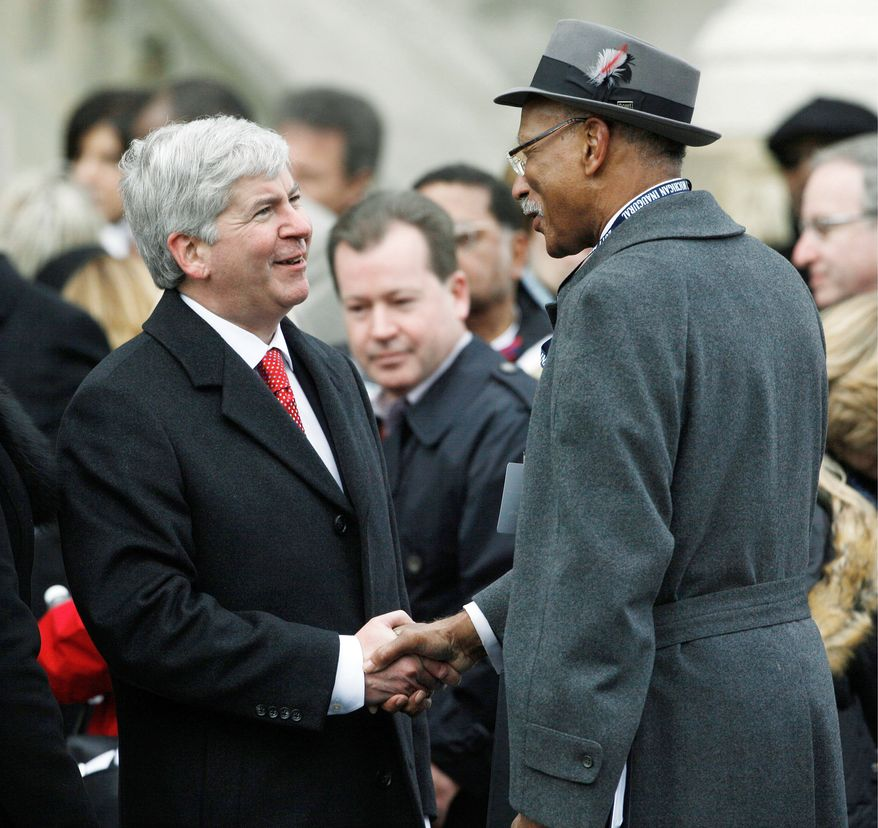 """Detroit Mayor Dave Bing (right), greeting Michigan Gov. Rick Snyder at his Jan. 1 inauguration, does not agree with the governor's idea of a state takeover of his troubled city. """"We know what needs to be done, and we stand ready to do it,"""" Mr. Bing said. (Associated Press)"""