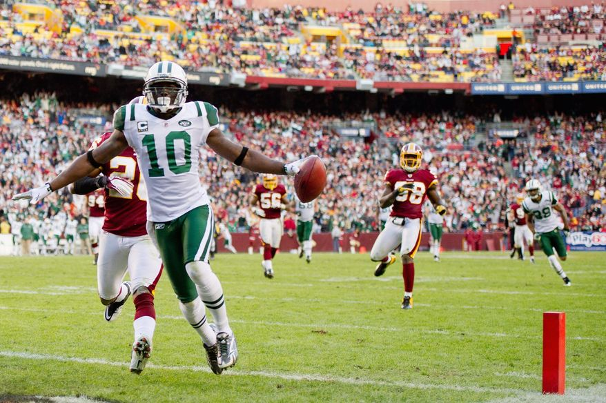 Jets wide receiver Santonio Holmes scores on a 30-yard pass with 4:49 left in the fourth quarter Sunday to give New York the lead for good. The Redskins secondary was burned late after limiting the Jets passing game for much of the game. (Andrew Harnik/The Washington Times)