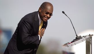 Former corporate executive Herman Cain greets the crowd Saturday at a campaign event in Atlanta, where he suspended his Republican presidential campaign. (Associated Press)