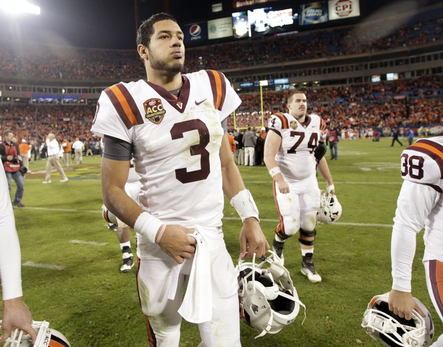 Virginia Tech quarterback Logan Thomas walks off the field after its 38-10 loss to Clemson in the Atlantic Coast Conference championship game in Charlotte, N.C., Saturday, Dec. 3, 2011. (AP Photo/Chuck Burton)