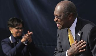 Republican presidential candidate Herman Cain announces to supporters on Saturday, Dec. 3, 2011, in Atlanta that he was suspending his campaign. (AP Photo/David Tulis)