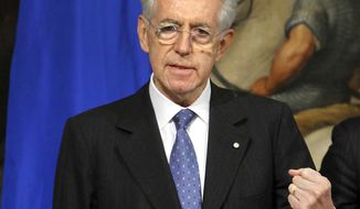 Italian Premier Mario Monti talks to journalists at the Chigi Palace, the premier's office, in Rome on Tuesday, Nov. 29, 2011. (AP Photo/LaPresse, Mauro Scrobogna)