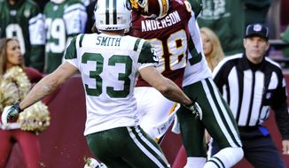 A pass to Washington Redskins wide receiver David Anderson is broken up by New York Jets' Antonio Cromartie on Sunday, Dec. 4, 2011, in Landover, Md. The Jets won 34-19. (AP Photo/The Free Lance-Star, Dave Ellis)